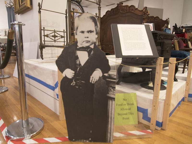 Cutout of George Stratton, a.k.a. General Tom Thumb. In the background, a brass bed frame that was made for Stratton and given as a gift while he was on tour with Barnum in England.