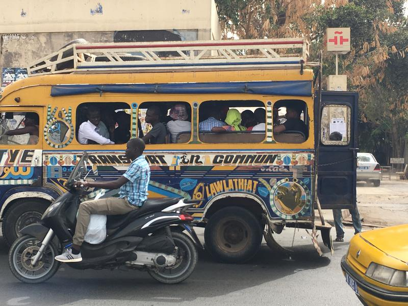The famous car rapide in Dakar, Senegal. The traffic congestion in Dakar is a sight to see. Locals often get a lift in these hand-painted mini-buses.