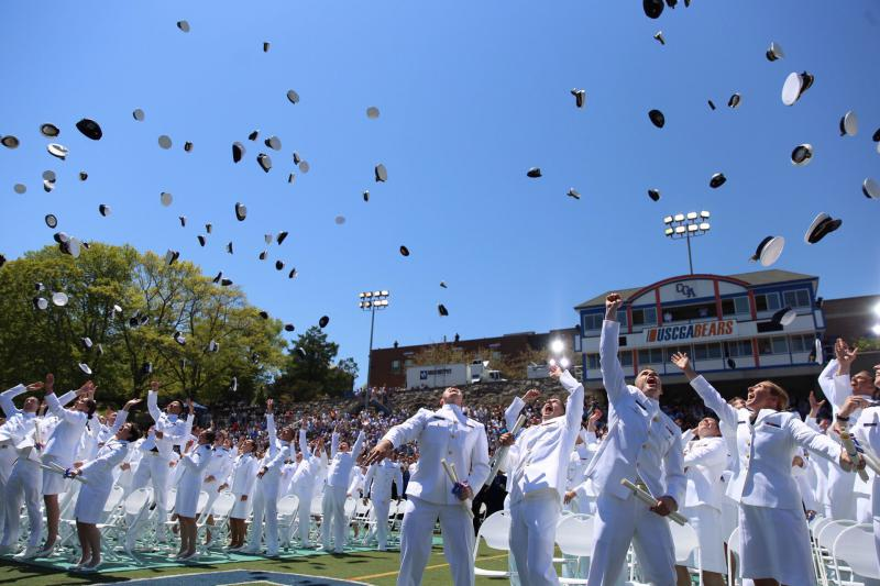 Cadets celebrate at the U.S. Coast Guard Academy in New London on Wednesday.