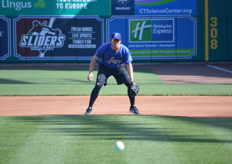 Yard Goats utility man Ashley Graeter fields grounders at first base.
