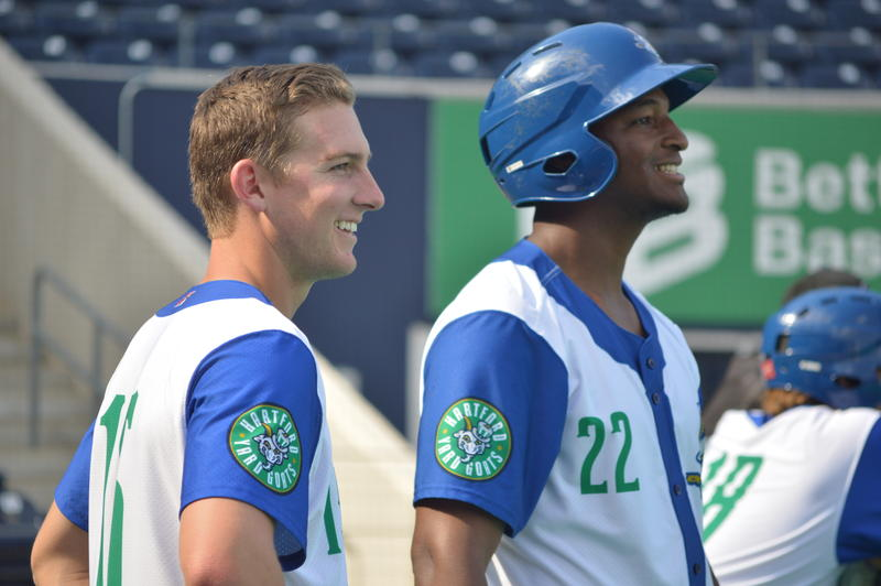 Infielder Ryan McMahon watches batting practice with Yard Goats teammate Correlle Prime (#22).