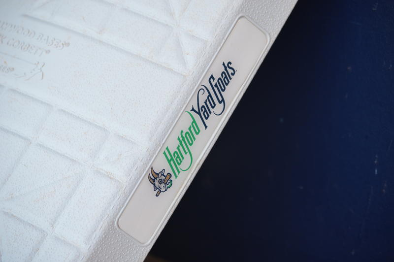 The Hartford Yard Goats wordmark as it adorns the bases at Dunkin' Donuts Park.