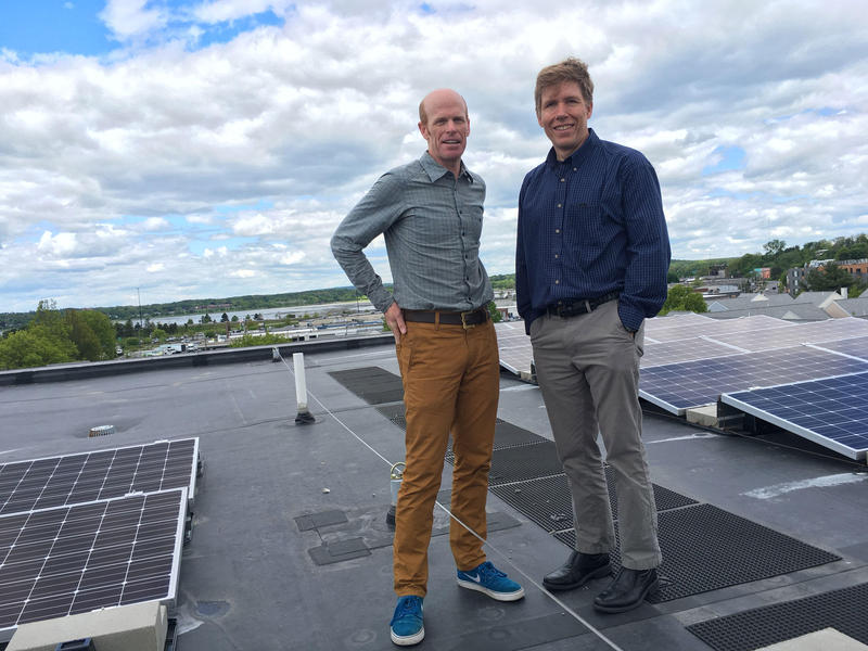 Jesse Thompson of Kaplan Thomas Architects and the Portland Housing Authority's Jay Waterman on top of ultra-efficient Bayside Anchor apartments in Portland, Maine.