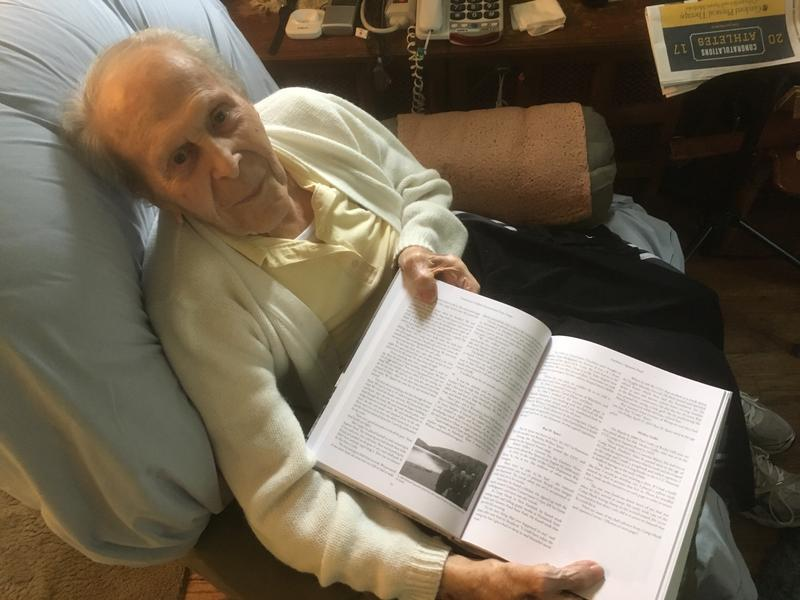 Former CCC boy Michael Popovich holds Martin Podskoch's book on the CCC at his home in West Hartford, CT
