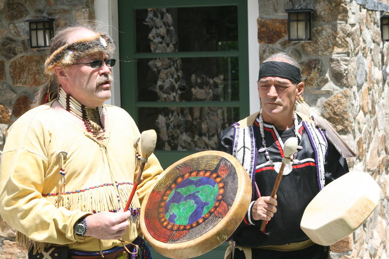 Mohegan man drumming during tribal ceremony
