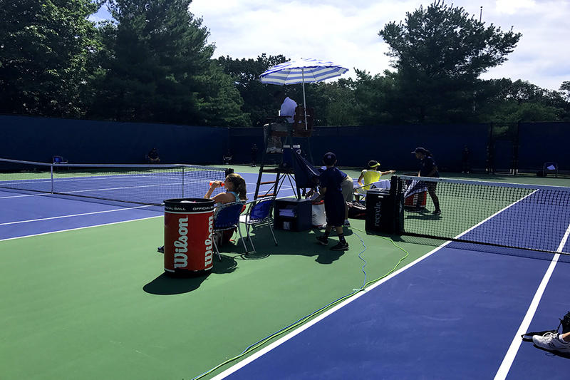 Ball kids prepare for the next set as tennis players take a rest during the 2017 Connecticut Open in New Haven.