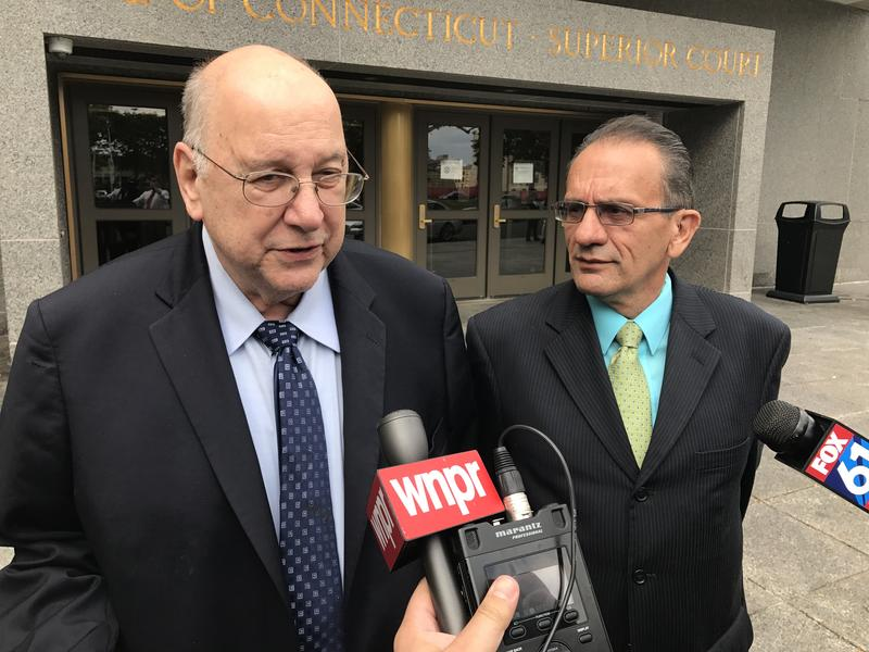 Former Hartford Mayor Eddie Perez leaves criminal court Thursday after pleading guilty to two felony charges. He was joined by his attorney Hubert Santos.