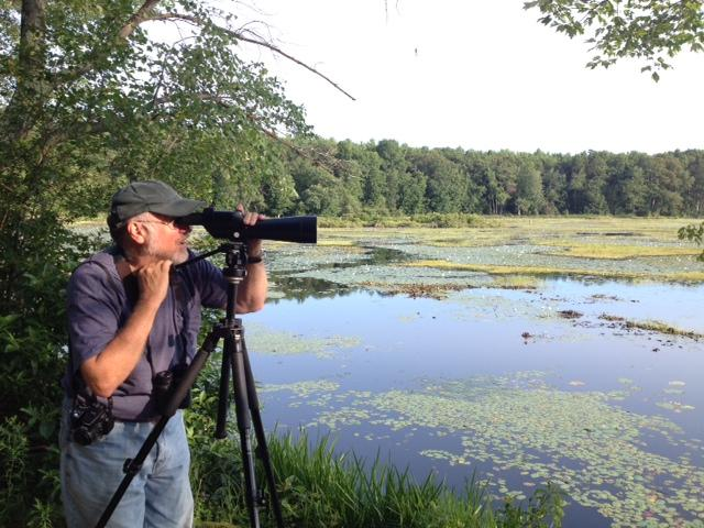 Bird watcher Greg Hanisek at Great Pond in Simsbury