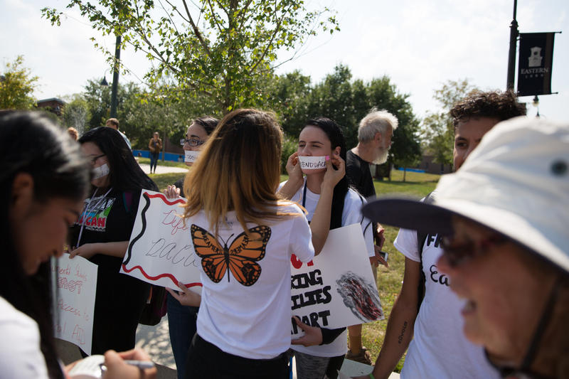 Students at Eastern Connecticut State University protest President Trump's decision to end protections for undocumented young people on Tuesday, September 5, 2017.