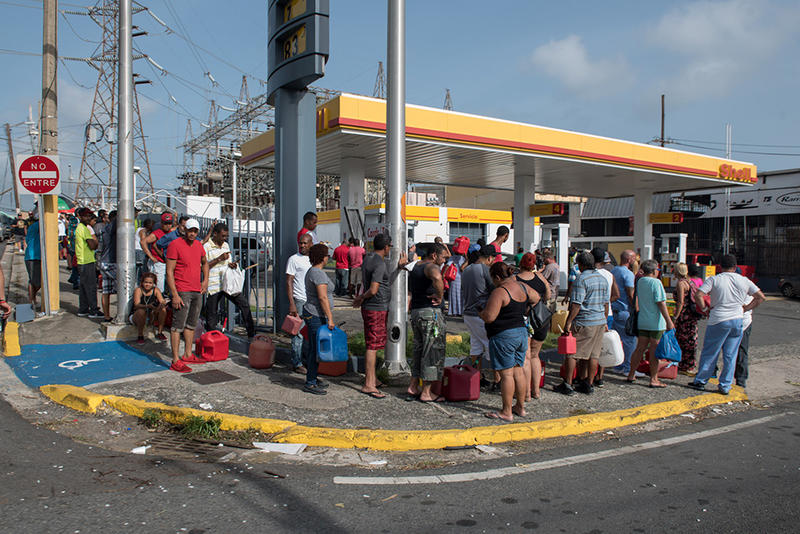 Crowds of people wait in line for gas at a Shell station in San Juan, Puerto Rico.