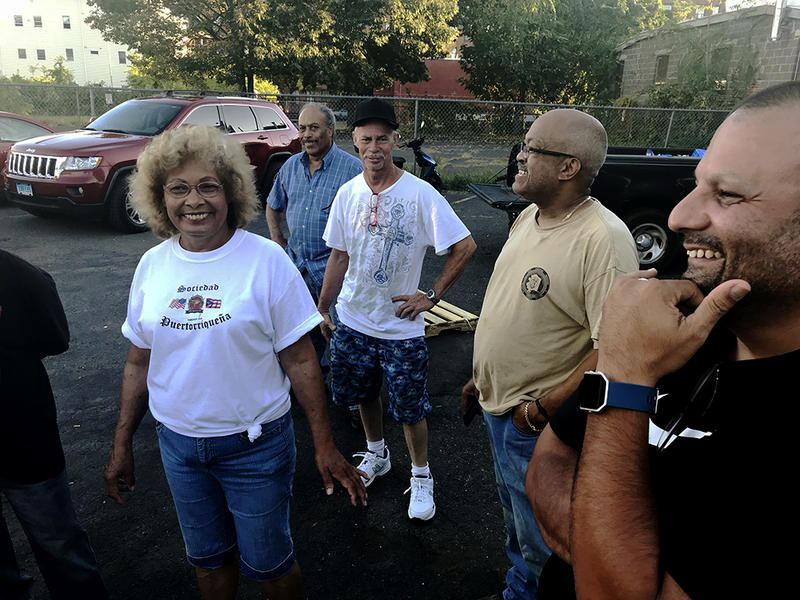 A group of Puerto Rican residents of New Britain led by Hamed Ayala (far right) volunteer at the Puerto Rican Society of New Britain, Wednesday.