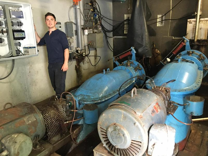 Goose River Hydro co-founder Nick Cabral shows off two turbine units inside the powerhouse at Mason's Dam.