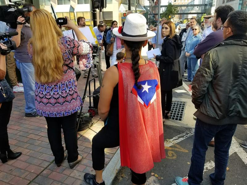 A woman shows her support for Puerto Rico during a rally in Hartford on Wednesday, Oct. 4.