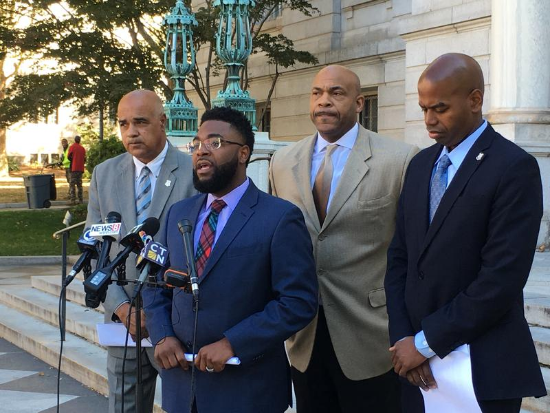 Members of Hartford's state delegation address the media outside City Hall Monday.