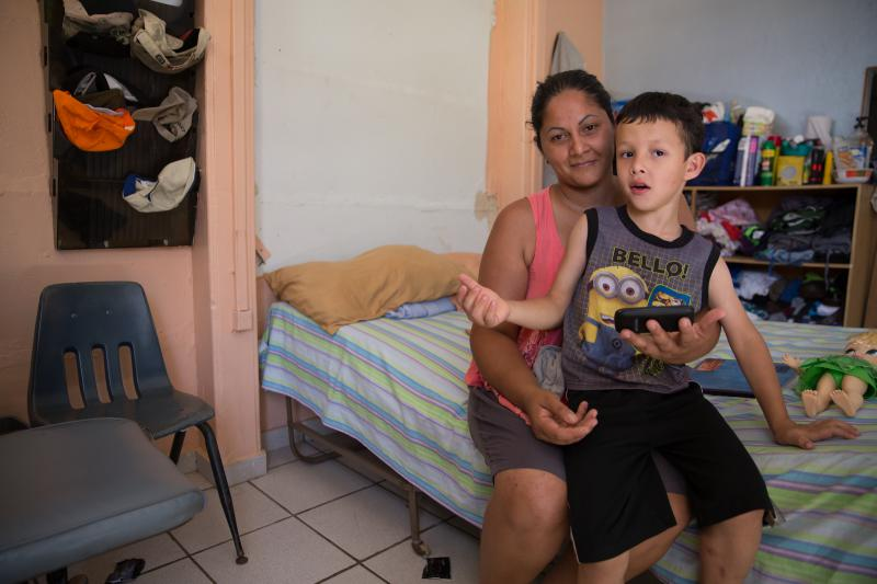 Abigail Ruiz and her family broke into an abandoned school when part of their home's roof blew off during the hurricane. They now live there.