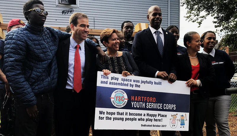Mayor Luke Bronin (second from left) met with members of the Youth Service Corps at a park they recently cleaned up on Bellevue Street in Hartford.