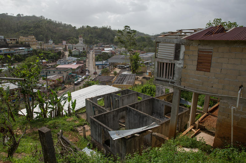 The small mountain town of Maricao, Puerto Rico. The hurricane tore part of the roof of the house on the right, so the family that lived there broke into an abandonded school in the town below to take shelter.
