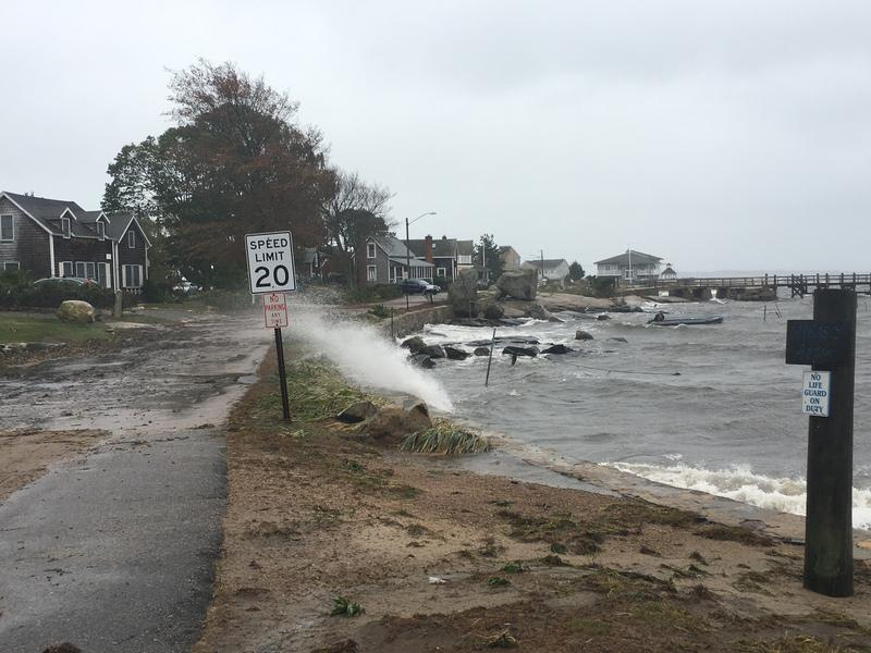 The sea overtops a wall in Stonington, Connecticut as high winds continue to batter the coastline.
