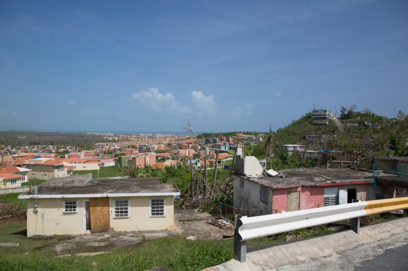 Houses in Humacao. Residents in this neighborhood said they've had little access to clean water. In the distance, the resort community of Las Palmas del Mar.