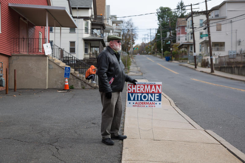 Jack Alseph stands in front of the St. Francis of Xavier Church in Waterbury to show his support for a local candidate on election day.