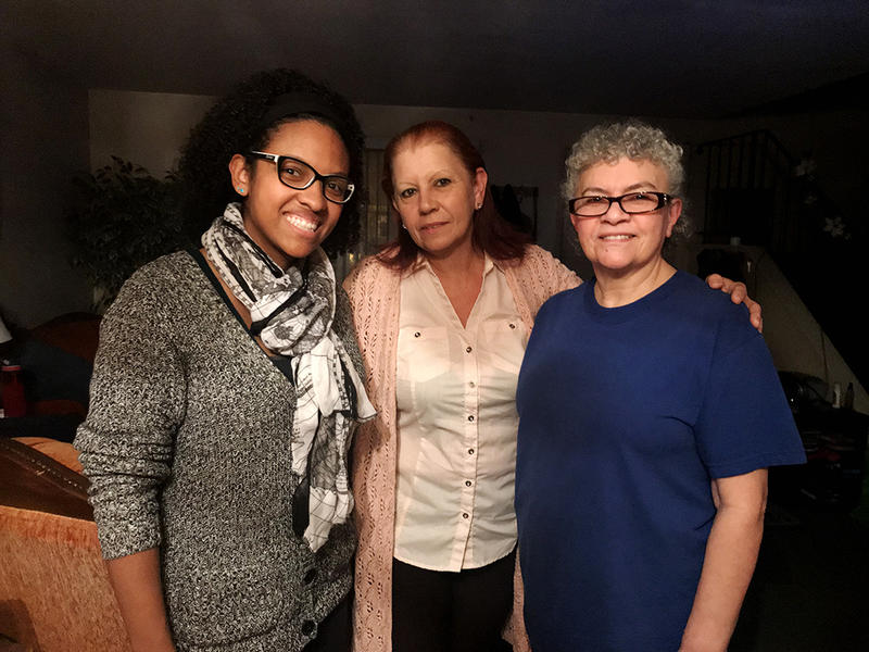 Sandra Rivera (middle) in her sister Ana Green's (right) New Britain apartment. Rivera is joined by her niece Annette Murphy (left).