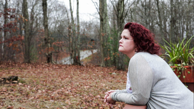 Heather Delaney, 40, looking out in her backyard.