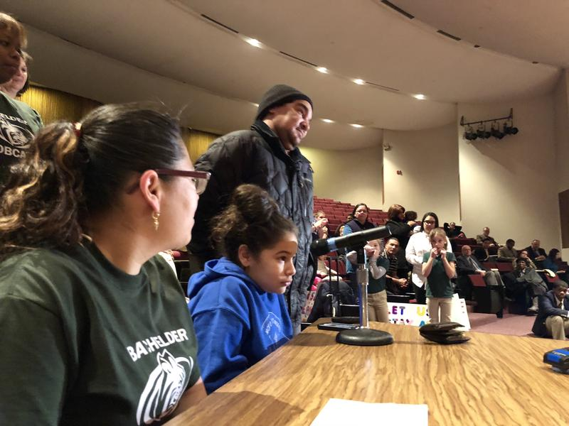 Antonio Cruz, a city school bus driver, addresses the Hartford school board at a public hearing Tuesday night. Cruz is the father of Paola Cruz, 9, a student at Batchelder Elementary School, which would close under the district's consolidation plan.