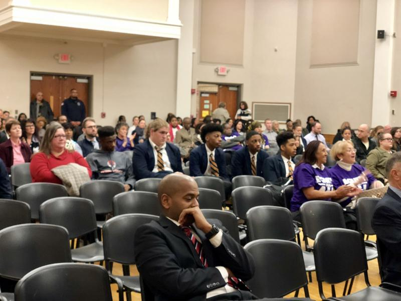 Audience members react after the Hartford school board votes unanimously to close schools.