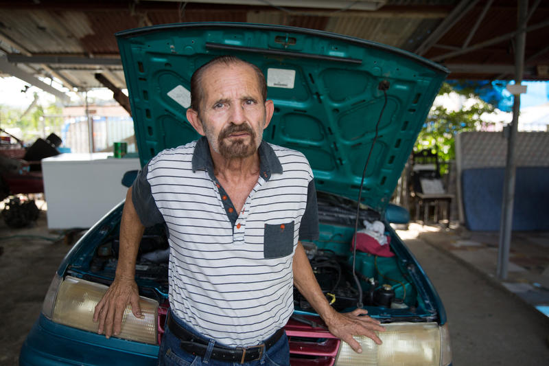 Alberto Díaz lives surrounded by cars. After Hurricane Maria's floods, none of them work. When Díaz built his house in Valle Hill, he raised his foundation so the home wouldn't flood. But Maria still brought a few feet of water inside.