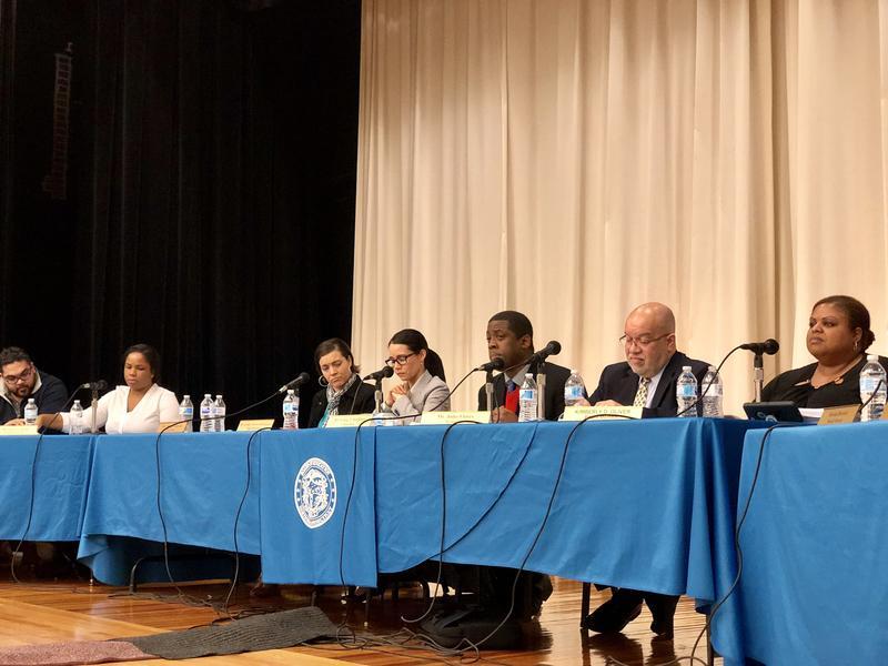 Hartford school board members listen to speakers before Tuesday night's vote to close two neighborhood schools.