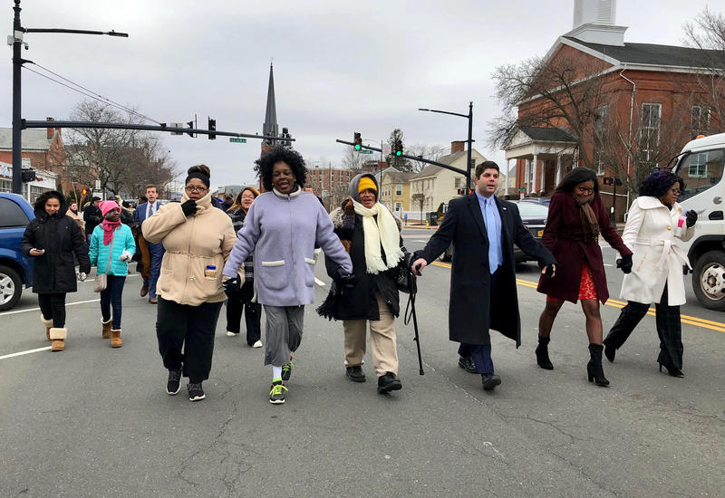 Marchers head down Main Street in Middletown during an annual celebration Monday honoring Dr. Martin Luther King Jr.