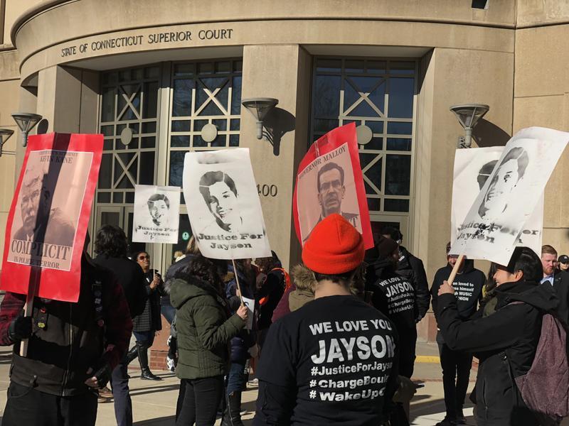 Demonstrators gather around Waterubry Superior Court on Friday.