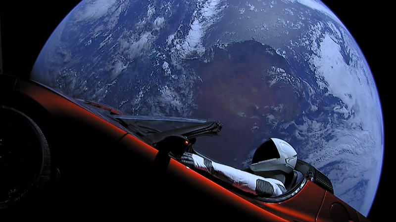 """Starman"" in Elon Musk's Tesla Roadster with Earth in the background"