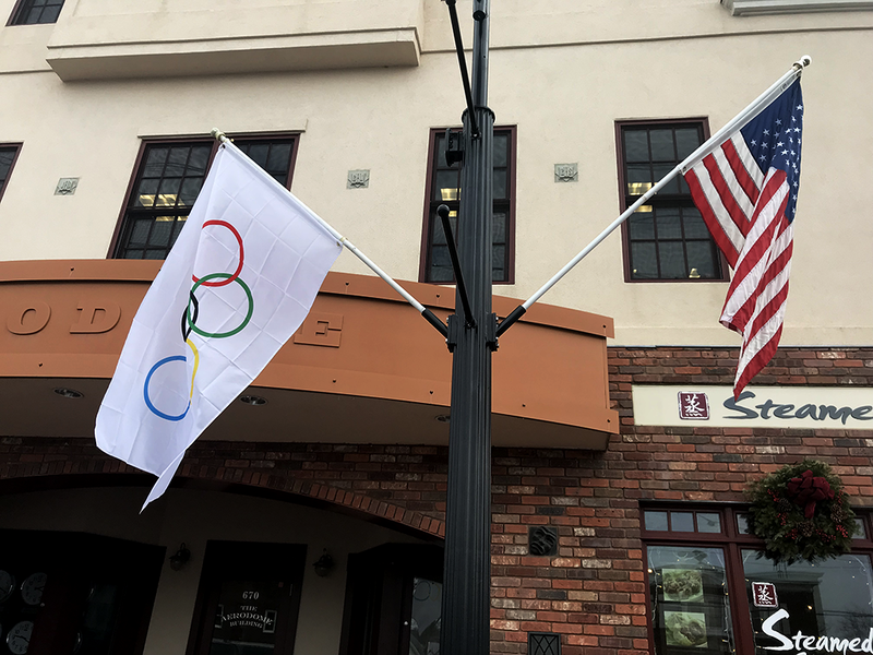 The flags fly in honor of Madison's three Winter Olympians.