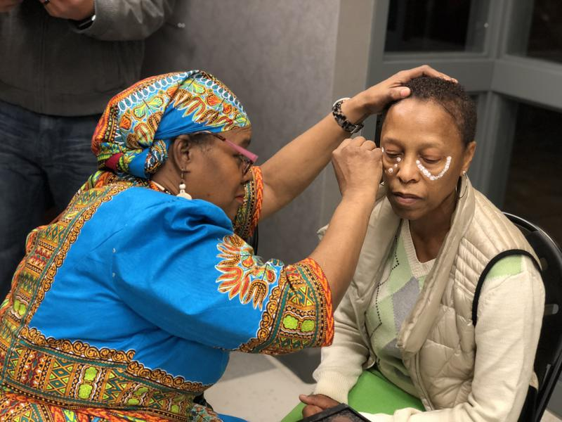 Sandra Inga, acting executive director for elementary and middle school education for Hartford Public Schools, gets her face painted by artist Martha Walker-Dawkins.