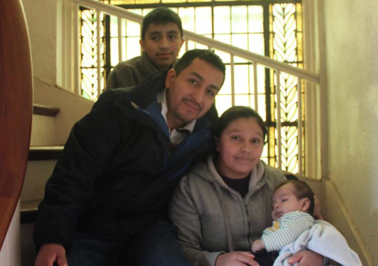 Paulina Lopez, 32, with her family inside the First and Summerfield United Methodist Church, New Haven.
