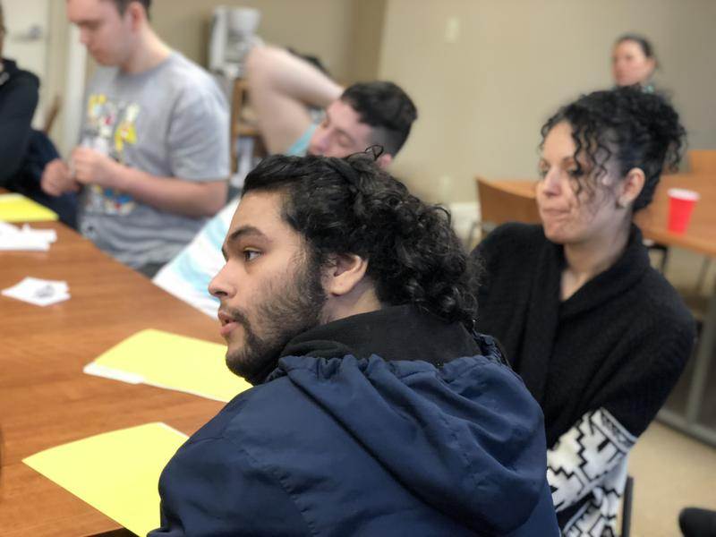 Edwin, 21, sits with other male students and helpers during an Oak Hill class this month