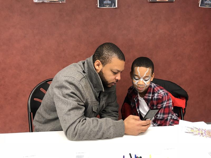 Shemell Gibson and his son Rishon, 10, a fifth-grader at Rawson STEAM School in Hartford, share a moment before seeing