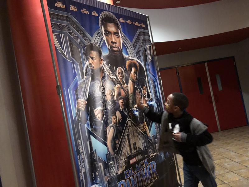 Trevian Banton, 8, a third-grader at St. Brigid-St. Augustine School in West Hartford, admires the image of Black Panther after seeing the movie.