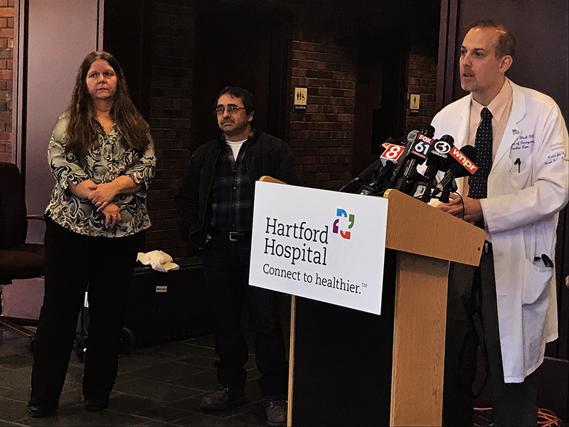 Dr. Jason Gluck (far right) explained how a device called ECMO works Tuesday at Hartford Hospital, while Victoria (far left) and husband Luis (center) looked on.