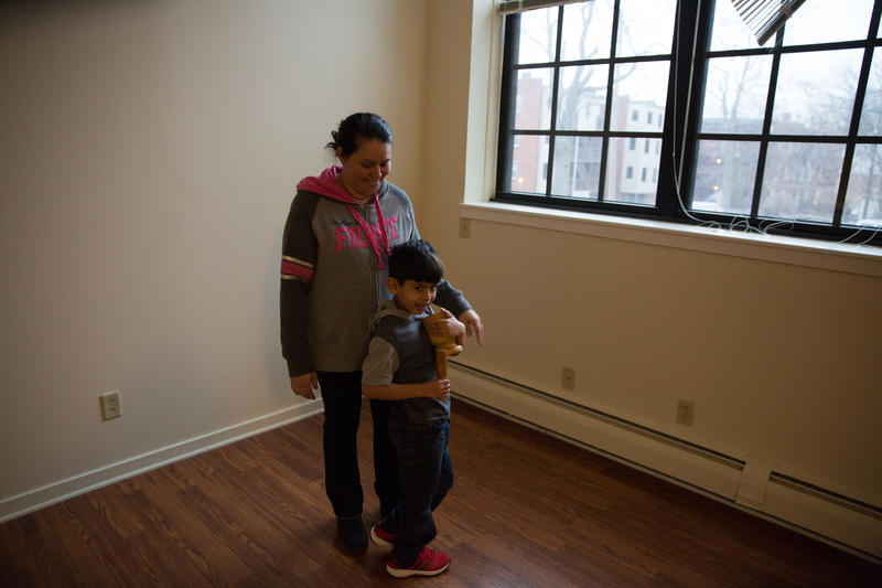 Wanda Ortiz stands in her new apartment with her grandson. They got the keys to the apartment just as their FEMA aid to live in a hotel in Hartford ran out.