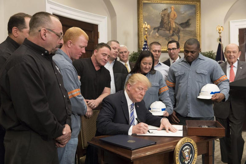 President Donald Trump signs a proclamation on steel and aluminum imports.