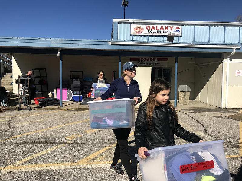 Shelby Carlson (left) follows Olivea Shelton (right) as they move boxes from the Galaxy Roller Rink in Groton into a moving truck on Saturday February 24.