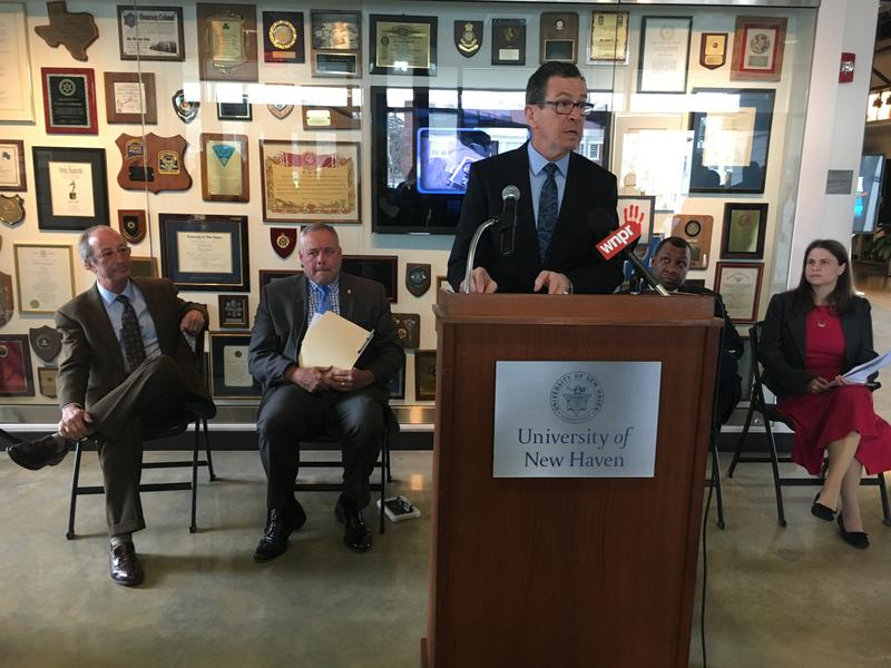 Gov. Malloy outlines juvenile justice proposals. Behind him, left to right, University of New Haven President Steven Kaplan, Commissioner Scott Semple, Sheriff Steven Tompkins, and Connecticut Juvenile Justice Alliance Executive Director Abby Anderson.