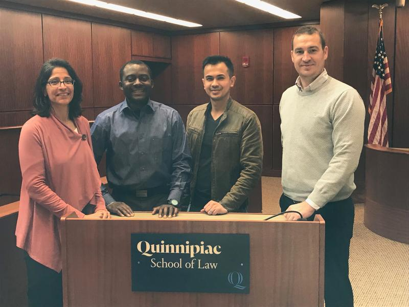 Sheila Hayre, visiting associate professor at Quinnipiac University School of Law, Congolese Artist Toto Kisaku and law students Thai Chhay and Brendan Lawless.