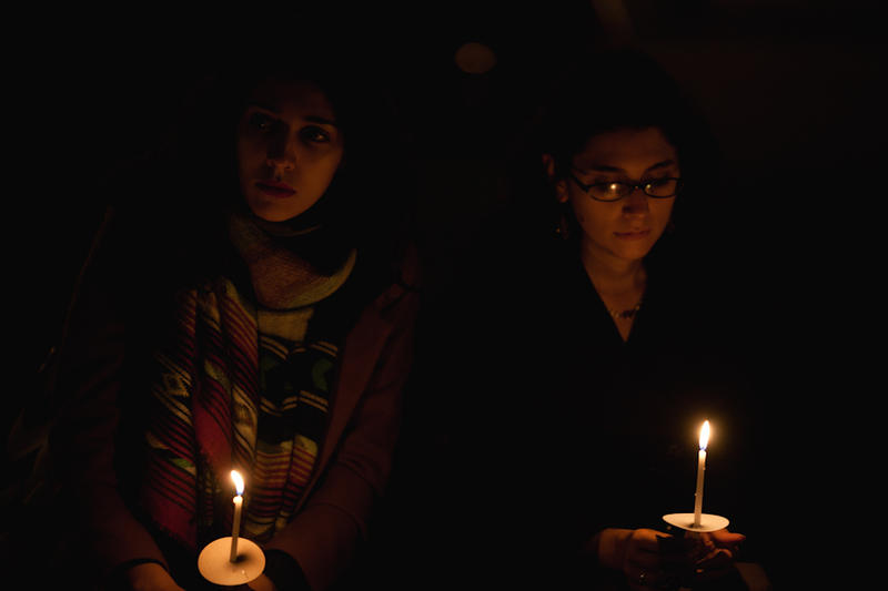 Two women at a vigil for murdered Native Canadian women in 2012.