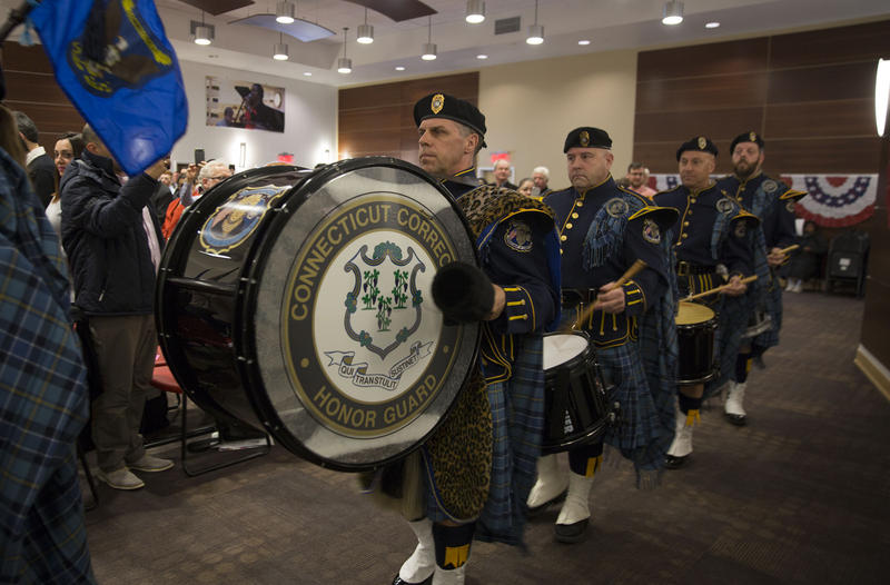 Members of the state Department of Corrections Honor Guard Pipe & Drum Band file into the ceremony room.