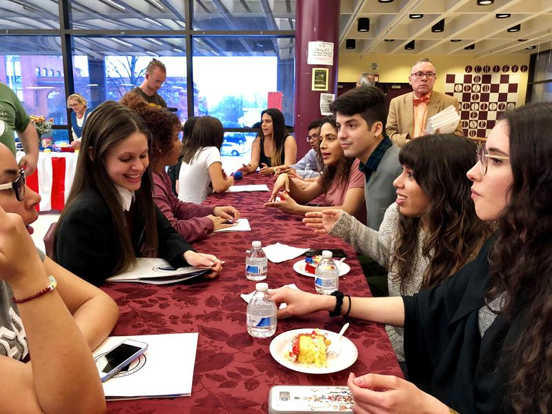 "Bulkeley High School senior Yeicy Alejandro, smiling at left, talks to her new mentors from Central Connecticut State University. They're in the new ""Ambassadors"" program - Puerto Rican evacuees helping other students displaced by Hurricane Maria."