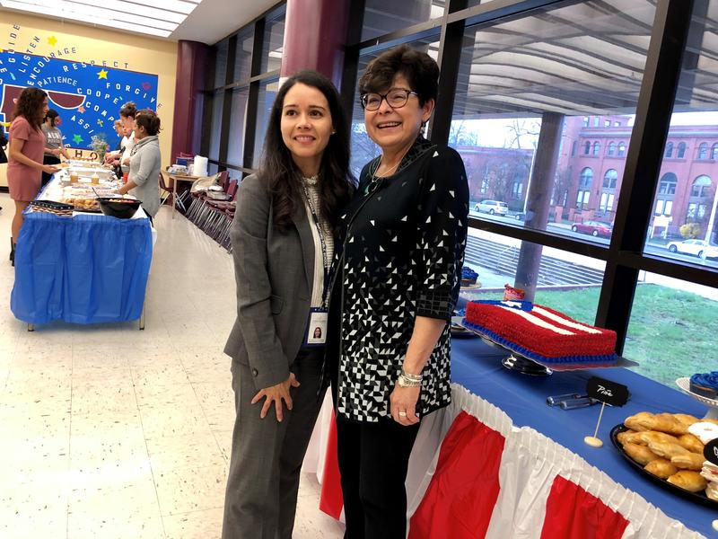 Hartford Superintendent Leslie Torres-Rodriguez, left, poses for a photo with Zulma Toro, the president of Central Connecticut State University, during a reception in the Bulkeley High School cafeteria.