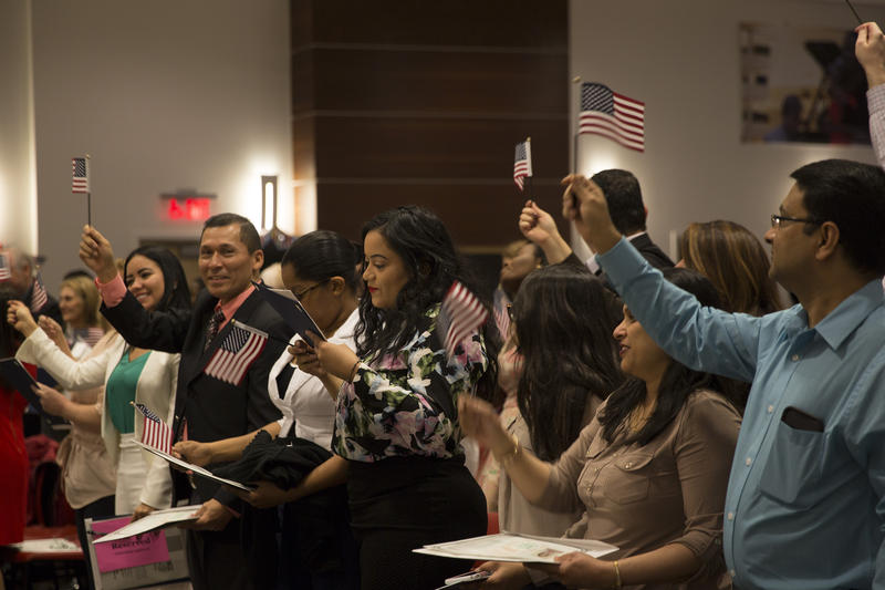 Newly minted U.S. citizens celebrated with American flags.